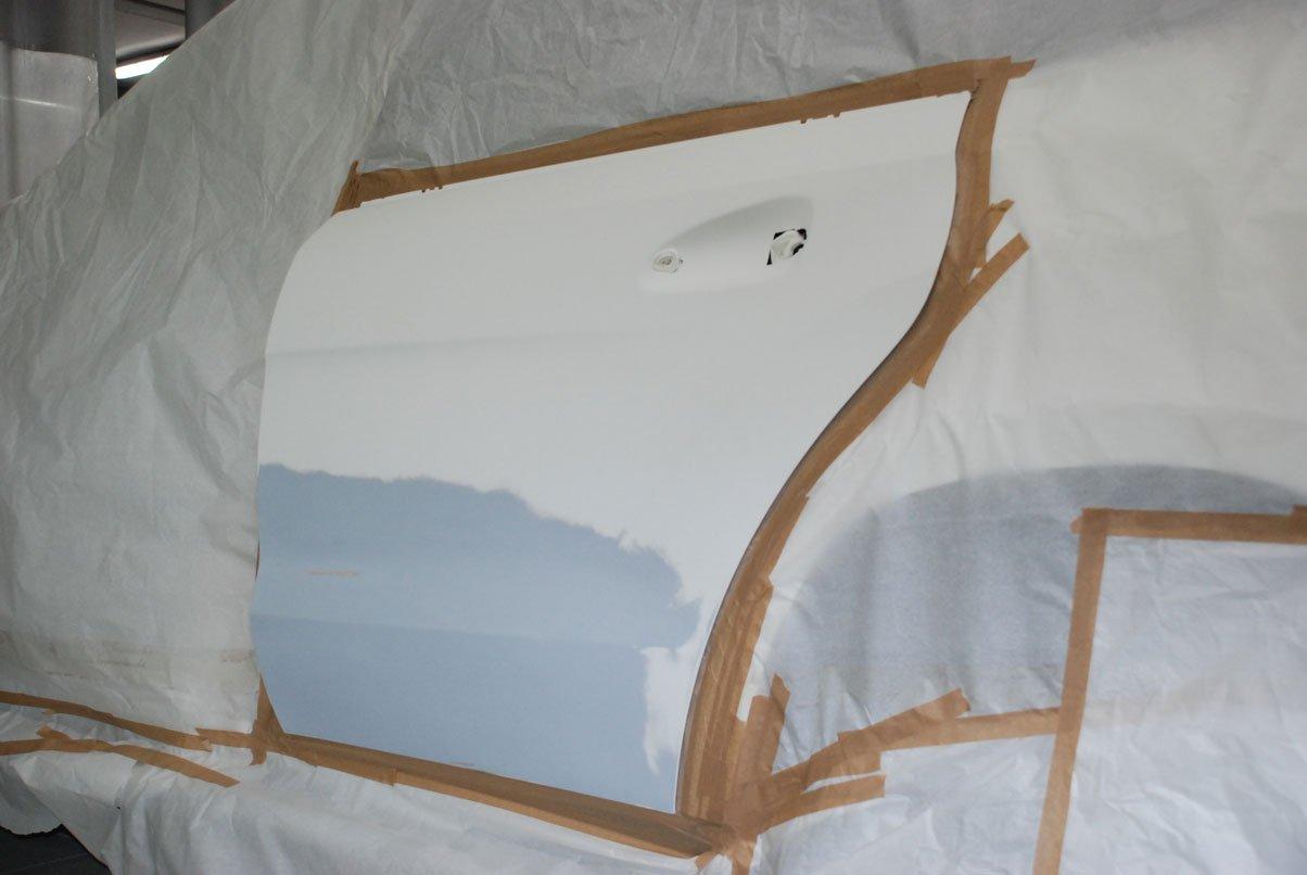 подготовленная к покраске дверь